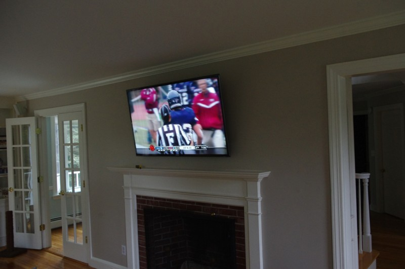 Wide View of TV Mounted over Fireplace