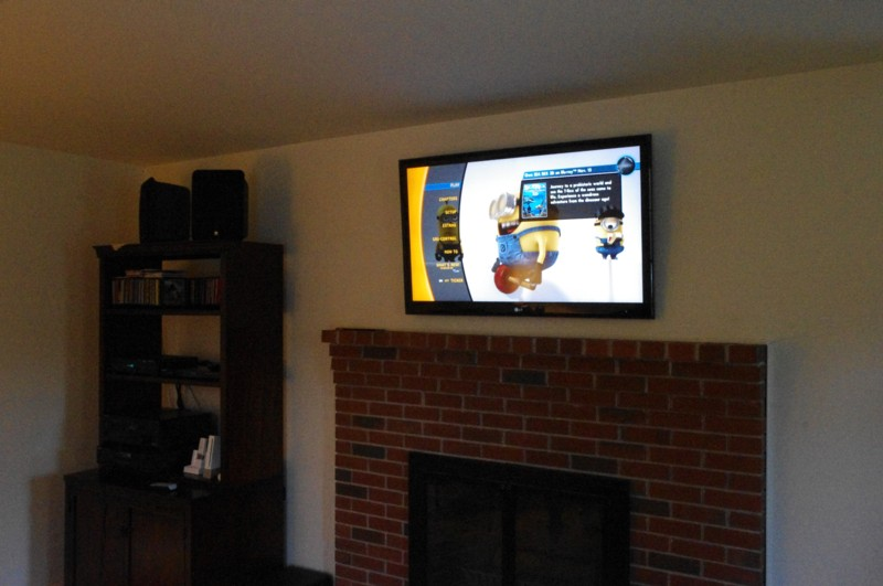 TV Mounted over brick fireplace